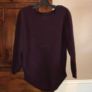 Maroon knit sweater with side slits